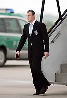 Photo: Chris Ratcliffe.<br />England arrival at Baden Airpot. 05/06/2006.<br />Wayne Rooney is all smiles as England land at Baden Baden.