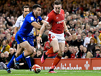 Rugby Union - 2020 Six Nations Championship - Wales vs. Italy<br /> <br /> Josh Adams of Wales chips ahead, at the Principality (Millennium) Stadium.<br /> <br /> COLORSPORT/WINSTON BYNORTH