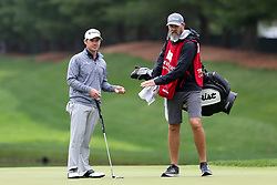 June 23, 2018 - Cromwell, Connecticut, United States - Brian Harman (L) and his caddie line up a putt on the 8th green during the third round of the Travelers Championship at TPC River Highlands. (Credit Image: © Debby Wong via ZUMA Wire)