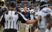 Football - NFL- Seattle Seahawks at St. Louis Rams.Seattle Seahawks head coach Pete Carroll looks on as a referee calms down a Seahawks player after a brief shoving match between him and a Rams player in the third quarter at the Edward Jones Dome in St. Louis.  The Rams defeated the Seahawks, 19-13.