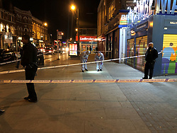 Police activity at a cordoned off area in High Road, Tottenham, after a suspected stabbing on Tuesday evening.