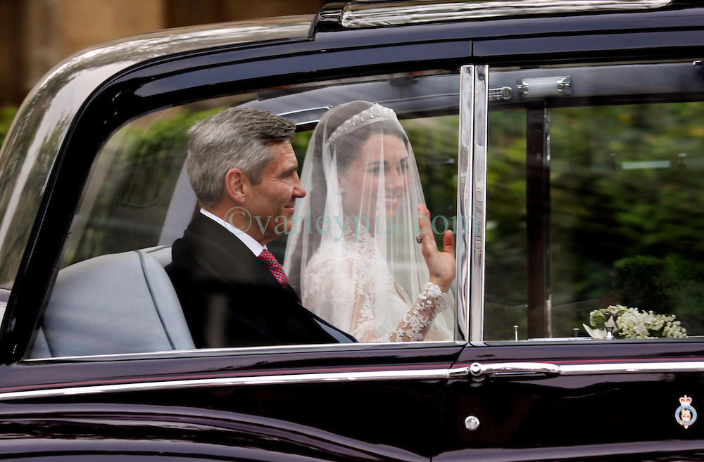 29 April 2011. London, England..Royal wedding day. Catherine (Kate) Middleton and her father Michael arrive at Westminster Abbey..Photo; Charlie Varley.
