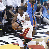 21 June 2012: Miami Heat shooting guard Dwyane Wade (3) goes to the basket against Oklahoma City Thunder power forward Serge Ibaka (9) during the Miami Heat 121-106 victory over the Oklahoma City Thunder, in Game 5 of the 2012 NBA Finals, at the AmericanAirlinesArena, Miami, Florida, USA. The Miami Heat wins the series 4-1.
