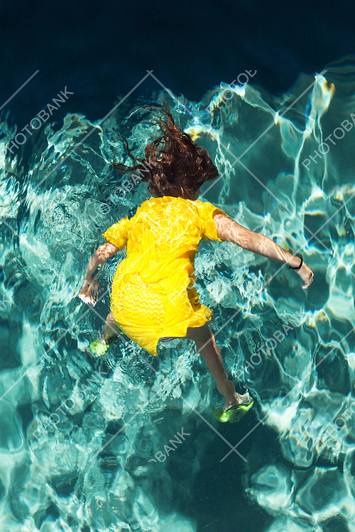 body of a girl in the pool, outdoors