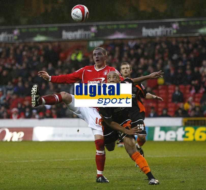 Photo: Richard Lane/Richard Lane Photography. Nottingham Forest v Blackpool. Coca Cola Championship. 13/12/2008. Joe Garner (L) and Alex Baptiste (R) contest the ball