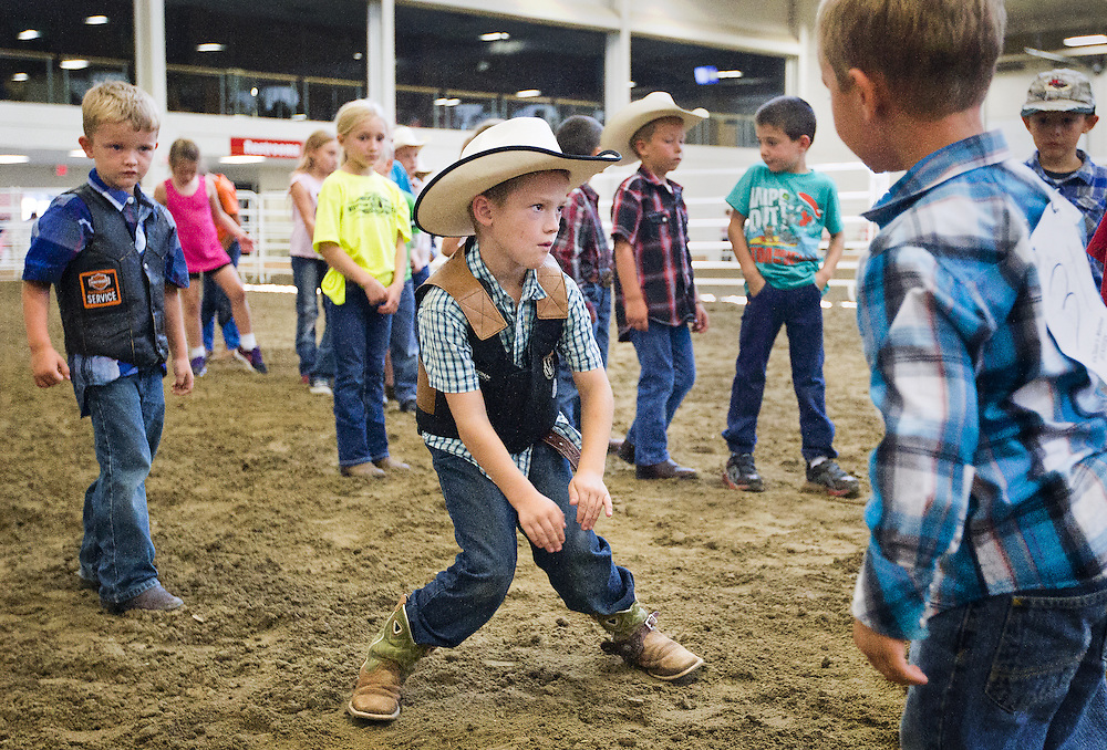 Collen Green, 6, of Syracuse, Neb., dances for the camera after competing in the Midwest Mutton Bustin Finals Friday in the Five Points Bank Arena at the Nebraska State Fair in Grand Island. (Independent/Matt Dixon)