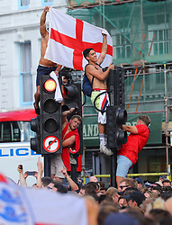 © Licensed to London News Pictures. 07/07/2018. London, UK. England fans celebrate the 2-0 victory over Sweden in the World Cup Quarter Finals on the street by London Bridge. Photo credit: Rob Pinney/LNP
