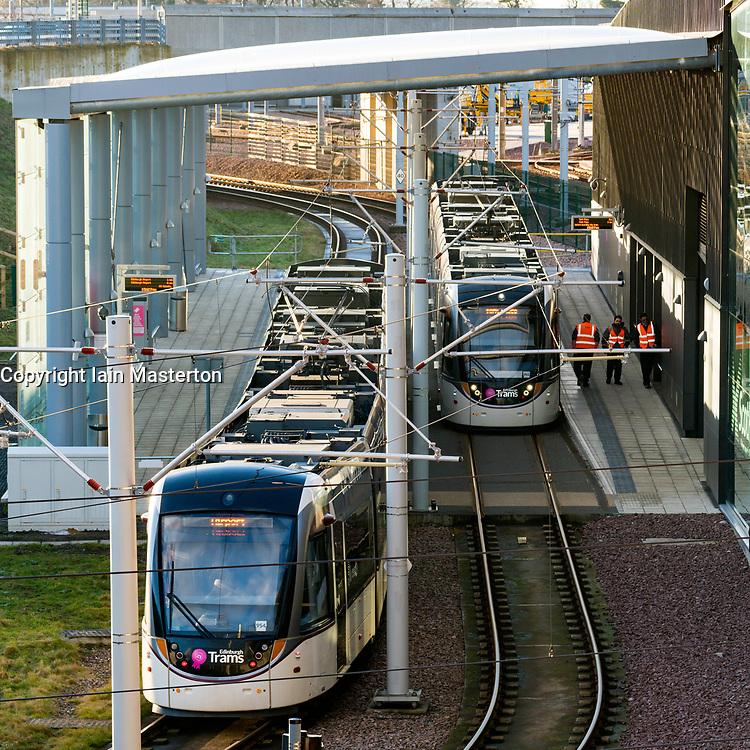 View of trams at platforms at modern Edinburgh Gateway railway and tram station that connects Scotrail train passengers with the Edinburgh Tram link  in Edinburgh, Scotland, United Kingdom.