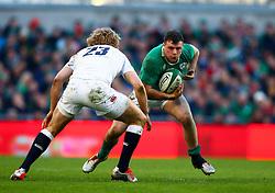 Ireland's Robbie Henshaw in action against England's Billy Twelvetrees - Photo mandatory by-line: Ken Sutton/JMP - Mobile: 07966 386802 - 01/03/2015 - SPORT - Rugby - Dublin - Aviva Stadium - Ireland v England - Six Nations