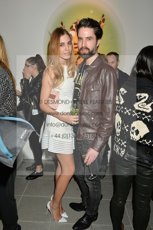 AMBER LE BON and JACK GUINNESS at the Future Contemporaries Party in association with Coach at The Serpentine Sackler Gallery, West Carriage Drive, Kensington Gardens, London on 21st February 2015.