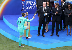 Netherlands goalkeeper Sari van Veenendaal receives The Golden Glove from FIFA President Gianni Infantino and French President Emmanuel Macron
