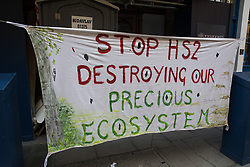 A Stop HS2 banner is pictured in St Martin's Lane during the first day of Impossible Rebellion protests by environmental activists from Extinction Rebellion on 23rd August 2021 in London, United Kingdom. Extinction Rebellion are calling on the UK government to cease all new fossil fuel investment with immediate effect. (photo by Mark Kerrison/In Pictures via Getty Images)