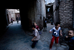 Children play in old city in Kashgar, China.