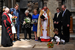 Dean of Westminster John Hall (third right), accompanied by first wife Jane Hawking (second left) and daughter Lucy Hawking (centre), presides over the internment of the ashes of scientist Professor Stephen Hawking in the nave during a memorial service at Westminster Abbey, London.
