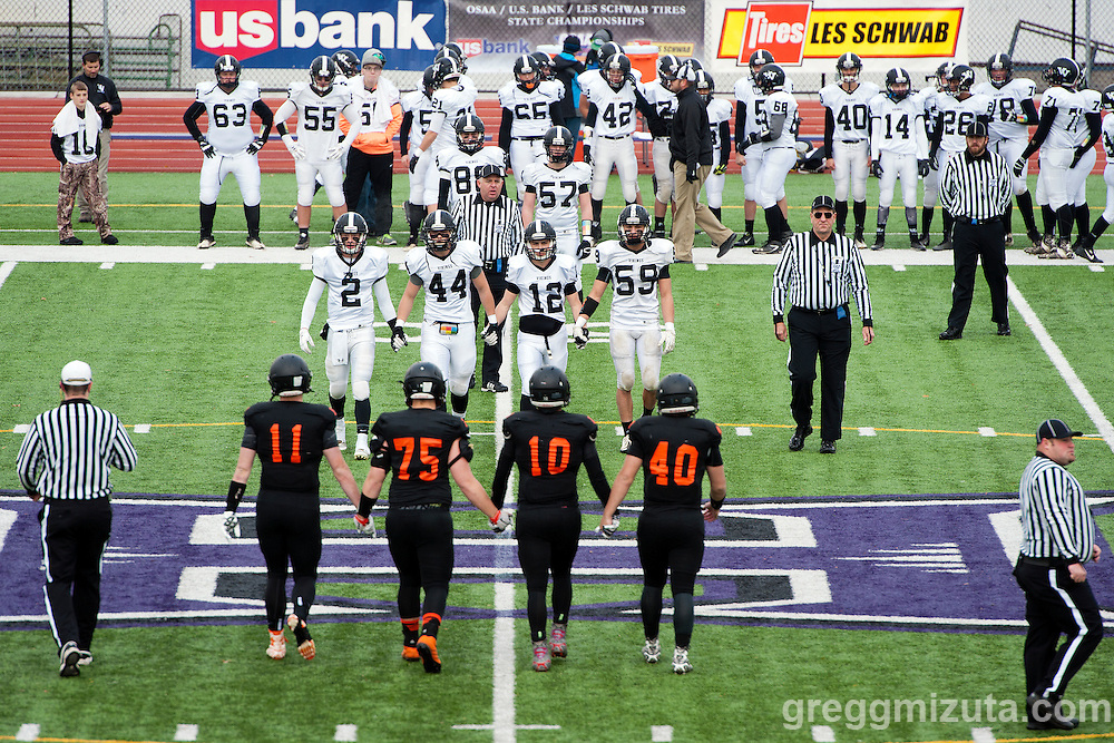 Vale team captains (L to R: Derek Hiatt, Trace Cummings, Zac Jacobs, Garret DeVos) and Scio team captains (L to R: Justin Parazoo, Taylor Lowther, Logan Ferguson, Logan Gray) meet for the coin toss before the start of the 3A semifinal playoff game at Kennison Field, Hermiston, Oregon, Saturday, November 21, 2015. Vale won 42-14.