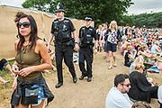 Police on patrol - The 2017 Latitude Festival, Henham Park. Suffolk 16 July 2017