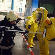 Verdacht poeder in bus Connexxion busstation Huizen, afspuiten gaspakken