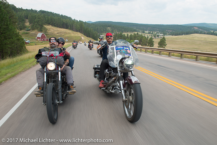 Missy and Darren McKeag on the Missy and Darren McKeag riding beside Bean're on the Aidan's Ride to raise money for the Aiden Jack Seeger nonprofit foundation to help raise awareness and find a cure for ALD (Adrenoleukodystrophy) during the annual Sturgis Black Hills Motorcycle Rally. Riding between Nemo and Rapid City, SD, USA. Tuesday August 8, 2017. Photography ©2017 Michael Lichter.