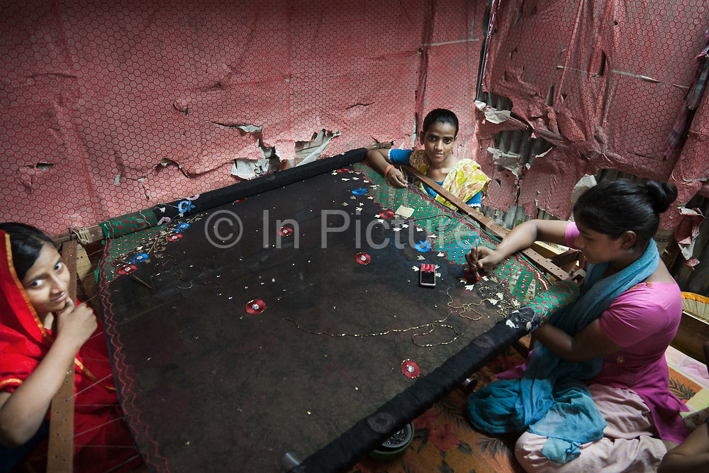 Dhaka, Bangladesh. The three girls, Rabia,18, Munni,15 and Sabia,13, work at home making saris. A factory out-let has commissioned the work. It  take s2 weeks to make a sari and they get £3 /sari each. Rabia and Munni are sister and both suffer from Rheumatic Arthritis and sitting down working 9 hours/ day seven days a week only makes their condition worse. Sabia wants to go to school but both Rabia and Muni prefer not to go out. Their disability has made them very shy, they cant walk properly and standing up Rabia is now only the size of a 10 year old. Her father says that if they were to go to school, who would then pay for their medication, not to mention the loss of income they generate...best to stay at home he says. The Stars Foundation visiting CSID.<br /> Centre for Services and Information on Disability (CSID) is a charity working for integrating disabled children into mainstream society.integrating disabled children into mainstream society.