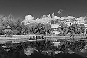 China, Tibet, Lhasa, View of the Potala Palace, with a pond and a reflection of the palace in the foreground.