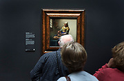 looking at the famous painting The Milkmaid by Vermeer in the Rijksmuseum amsterdam