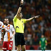 Referee's Suleyman Abay show the yellow card during their Turkish Superleague soccer match Galatasaray between Mersin Idman Yurdu at the AliSamiYen Spor Kompleksi at Aslantepe in Istanbul Turkey on Saturday 06 April 2013. Photo by Aykut AKICI/TURKPIX