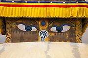 Close up of Buddha's eyes, Chabahil Stupa (Buddhist Shrine) with Prayer Flags, Kathmandu