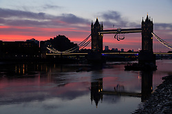 © Licensed to London News Pictures. 29/08/2012. London, UK. Pink sunrise behind the Paralympic Agitos on Tower Bridge in London on 29 August 2012, the day of the Opening Ceremony of the London 2012 Paralympic Games Photo credit : Vickie Flores/LNP.