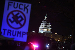 January 30, 2018 - Washington, District of Columbia, U.S. - Protestors hold signs outside of the United States Capitol prior to U.S. President Trump's State of the Union Address. (Credit Image: © Riccardo Savi via ZUMA Wire)