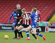 Mark Duffy of Sheffield Utd tussles with Paul Green of Oldham during the English League One match at Bramall Lane Stadium, Sheffield. Picture date: December 26th, 2016. Pic Simon Bellis/Sportimage