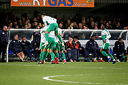 Plymouth players celebrate Plymouth midfielder David Fox's wonder goal (8) during the EFL Sky Bet League 1 match between AFC Wimbledon and Plymouth Argyle at the Cherry Red Records Stadium, Kingston, England on 26 December 2018.