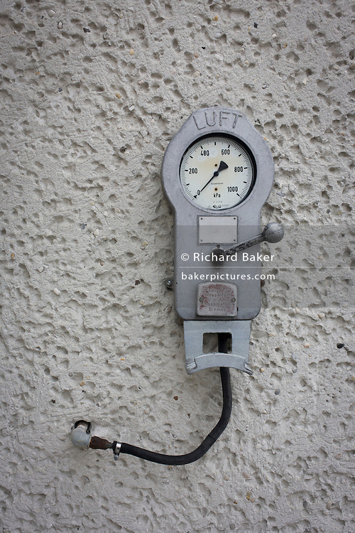 Detail of an air pressure pump mounted to a wall in the notorious secret police (Stasi) Hohenschonhausen prison. The Berlin-Hohenschönhausen Memorial is now a museum and memorial located in Berlin's north-eastern Lichtenberg district. Hohenschönhausen was a very important part of the Socialist GDR's (German Democratic Republic) system of political and artistic oppression. Although torture (including Chinese water torture) and physical violence were commonly employed at Hohenschönhausen (especially in the 1950s), psychological intimidation was the main method of political repression and techniques including sleep deprivation, total isolation, threats to friends and family members. Between 1950 and 1989, the Stasi employed a total of 274,000 people in an effort to root out the class enemy. The Hohenschonhausen prison's existence was largely unknown to locals - another blank on the map. During Hitler's Third Reich, the Gestapo had one agent for every 2,000 citizens whereas the Stasi had approximately an spy for every 6.5. German media called East Germany 'the most perfected surveillance state of all time' - administered from this complex of offices.