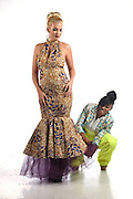 Hartford, CT, 8/24/2016<br /> Fashion designer Chinnyere McPherson of New Britain adjust one of her dresses on model Alexa Pagnani of East Haddam.<br /> Photo by MARA LAVITT/ Special to the Courant.
