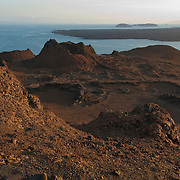 Evening sun bathes the landscape of the summit on Bartolome Island, an Island in the Galapagos that has a moon-like landscape. Ecuador