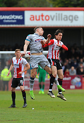 Sam Jones of Grimsby Town and James Rowe of Cheltenham Town compete for the high ball  - Mandatory by-line: Nizaam Jones/JMP - 17/04/2017 - FOOTBALL - LCI Rail Stadium - Cheltenham, England - Cheltenham Town v Grimsby Town - Sky Bet League Two