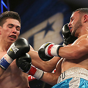 TAMPA, FL - FEBRUARY 28:  Christopher Diaz (R) lands a punch to the face of Luis Ruiz Jr. during the SoloBoxeo Tecate boxing match at the University of South Florida Sundome on February 28, 2015 in Tampa, Florida. Diaz won the bout by unanimous decision.   (Photo by Alex Menendez/Getty Images) *** Local Caption *** Christopher Diaz; Luis Ruiz Jr.