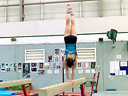 Gymnast, Beth Tweddle training on the balance beam at the City of Liverpool Gymnastics club, UK prior to the 2012 London Olympic Games. A three-time Olympian, Beth Tweddle competed in the 2004 Athens, 2008 Beijing, and 2012 London Olympic Games, where she took home a bronze medal on the uneven bars, the first Olympic medal for a British female gymnast. Tweddle retired in August 2013.