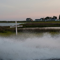 August 4, 2017 - Tangier Island, VA - A jet skier cruises through the waterways of Tangier Island, where crosses show the populations dedication to their Christian religion.<br /> Photo by Susana Raab/Institute