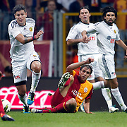 Galatasaray's Johan ELMANDER (C) and Eskisehirspor's Diego Angelo De OLIVERA (L) during their Turkish Super League soccer match Galatasaray between Eskisehirspor at the TT Arena at Seyrantepe in Istanbul Turkey on Monday, 26 September 2011. Photo by TURKPIX