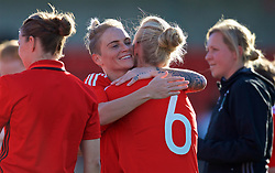 YSTRAD MYNACH, WALES - Wednesday, April 5, 2017: Wales' Jessica Fishlock hugs captain Sophie Ingle after the 3-1 win in the Women's International Friendly match against Northern Ireland at Ystrad Mynach. (Pic by Laura Malkin/Propaganda)