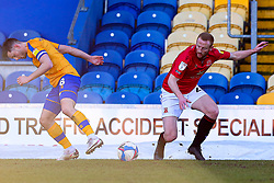 Ollie Clarke of Mansfield Town and Liam Gibson of Morecambe go for the ball - Mandatory by-line: Ryan Crockett/JMP - 27/02/2021 - FOOTBALL - One Call Stadium - Mansfield, England - Mansfield Town v Morecambe - Sky Bet League Two