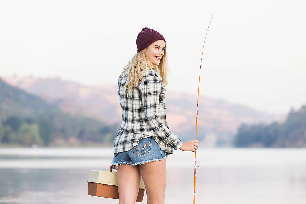 Outdoors lifestyle photographer Raymond Rudolph photographs model Heather Nolan fishing at Del Valle Reservoir in Northern California