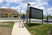 University of Maryland graduation with 2 year old child and father walking