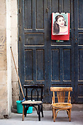 A picture of a woman and two chairs on the street, Bein al-Qasreen area, Islamic Cairo, Cairo, Egypt