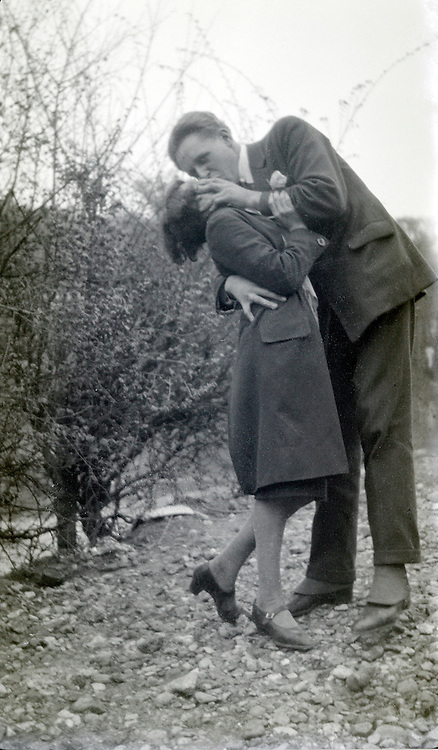 boy and girl kissing outside 1920s