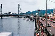 CS03386. Portland Waterfront, old Harbor Drive, Hawthorne Bridge, Rose Festival June 1971 submarine, circus, taken from Morrison bridge looking south.