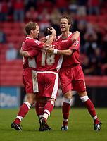 Photo: Jed Wee.<br />Darlington v Swindon Town. Coca Cola League 2. 19/08/2006.<br /><br />Swindon's Andy Monkhouse (R) and Jamie Vincent (L) celebrate with goalscorer Paul Evans.