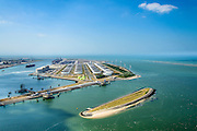 Nederland, Zuid-Holland, Rotterdam, 10-06-2015; Yangtzehaven met Maasvlakte Olie Terminal (MOT), links de drie tanks van Gate terminal. In de voorgrond Nijlhaven met Beereiland (Zeehondeneiland)<br /> Yangtzehaven with Maasvlakte Oil Terminal (MOT), including the three tanks of  the Gate terminal for LNG import. In the foreground Nile Haven with Bear Island (Seal Island).<br /> <br /> luchtfoto (toeslag op standard tarieven);<br /> aerial photo (additional fee required);<br /> copyright foto/photo Siebe Swart