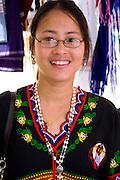 Woman of the Karen Community from Burma (Myanmar) wears ethnic clothing. Dragon Festival Lake Phalen Park St Paul Minnesota USA