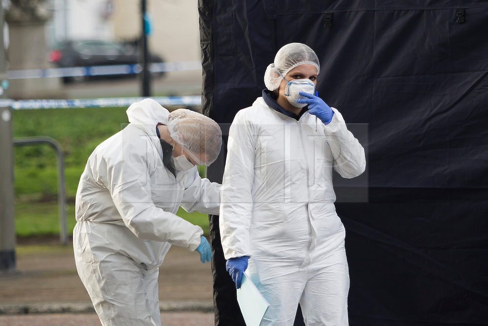 © Licensed to London News Pictures. 11/01/2017. Brighton, UK. Forensic officers leave the tent that covers the body of a pedestrian who was killed by a car that was being persued by police on Tuesday Evening. The vehicle in question was later found abandoned Madeira Drive. The pedestrian was pronounced dead at the scene. Photo credit: Hugo Michiels/LNP